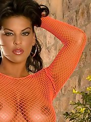 Big Breasts Latina in Fishnet on Porch